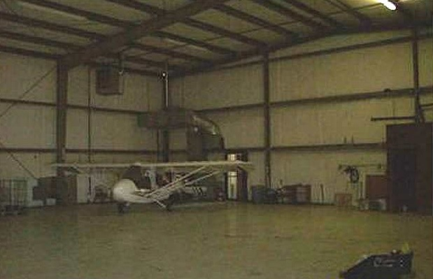 Plane inside of hangar